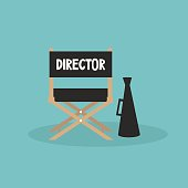 Film industry. Director's chair and megaphone