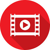 Vector illustration of a red film strip with play button icon in flat style.