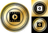 Film Play.This image features the main icon on a round sticker design. The image is a  vector illustration. The colors are black, white and golden gradient. It's placed against a white background. There are two more alternative designs of the seal on the right of the image. This royalty free vector illustration is easy to modify.This image features the main icon on a round sticker design. The image is a  vector illustration. The colors are black, white and golden gradient. It's placed against a white background. There are two more alternative designs of the seal on the right of the image. This royalty free vector illustration is easy to modify.