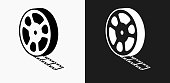 Film Reel Icon on Black and White Vector Backgrounds. This vector illustration includes two variations of the icon one in black on a light background on the left and another version in white on a dark background positioned on the right. The vector icon is simple yet elegant and can be used in a variety of ways including website or mobile application icon. This royalty free image is 100% vector based and all design elements can be scaled to any size.