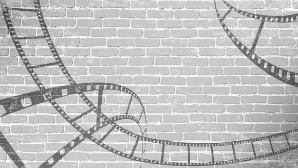 illustrazioni stock, clip art, cartoni animati e icone di tendenza di striscia di pellicola su muro di mattoni grigi. sfondo in stile cinematografico su parete di mattoni. vecchio sfondo astratto cinema. cinema movie time concept . mulinello pellicola in stile isometrico 3d. illustrazione vettoriale - cinema