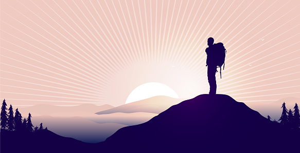 Male person watching epic landscape and sunrise from top