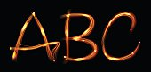 Letters ABC drawn in fire ovet black style glowing in the night. Vector illustration.