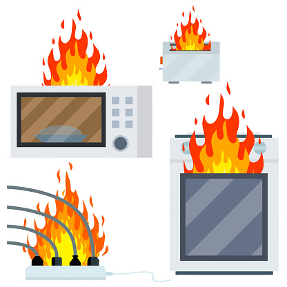 Fire on the stove. Burning microwave, toaster, wire with cable and socket