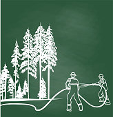 Two firemen putting a stop to a forest fire