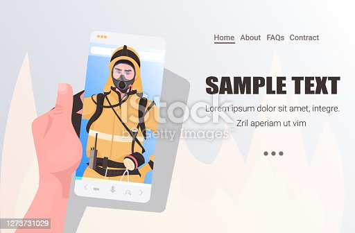 istock firefighter in uniform on smartphone screen self isolation online communication concept horizontal 1273731029