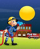 Fireman holding  a hose