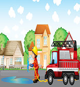fireman holding hose with a fire truck at the back