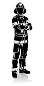 A silhouette fireman standing with arms crossed