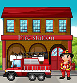 Fireman with a fire truck in firestation