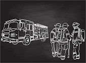 Firemen working together and firetruck in the background