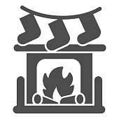 Fireplace with bonfire and socks solid icon, Christmas concept, New Year living room interior sign on white background, Christmas fireplace icon in glyph style for mobile. Vector graphics