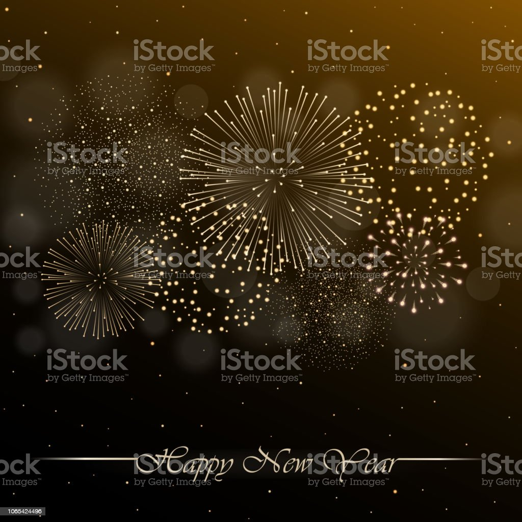 firework show on golden night sky background with glow and sparkles new year concept