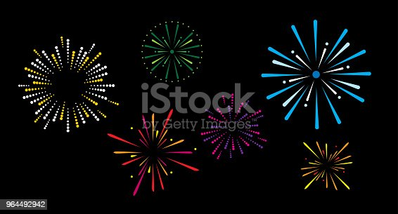 Vector illustration of various fireworks exploding against a black background.