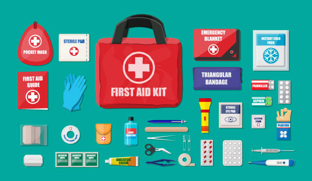 first aid kit with medical equipment - first aid stock illustrations, clip art, cartoons, & icons