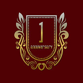 First anniversary vintage symbol. Golden emblem with numbers on shield in wreath.