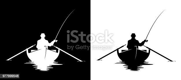 istock Fisherman in boat silhouette 977999548
