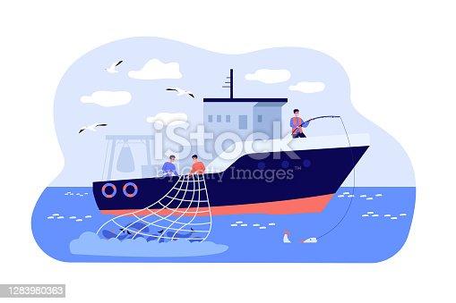Fishermen sailing boat in sea