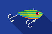 Vector illustration of a fishing lure against a blue background in flat style.