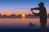 Silhouette of fisherman on sunset background
