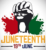 Fist and Splashed African Colors for Juneteenth Celebration