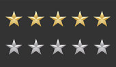 istock Five gold and silver shape stars quality icon on a dark background. 5 gradient rating stars. EPS 10 vector rank illustration 1188885673