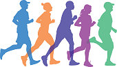 istock Five People Running Together Silhouettes 910314582