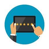 Five Star Rating on Dark Tablet Screen With Hands