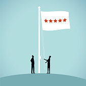 Two people raise a flag to celebrate a star performance