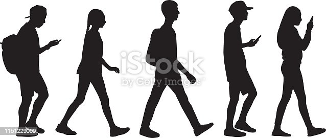 Vector silhouette of five teens walking in line.