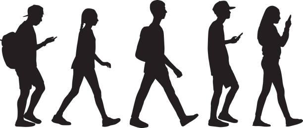 Five Teens Walking In Line Vector silhouette of five teens walking in line. digital native stock illustrations