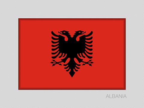 Flag of Albania. National Ensign Aspect Ratio 2 to 3 on Gray Cardboard