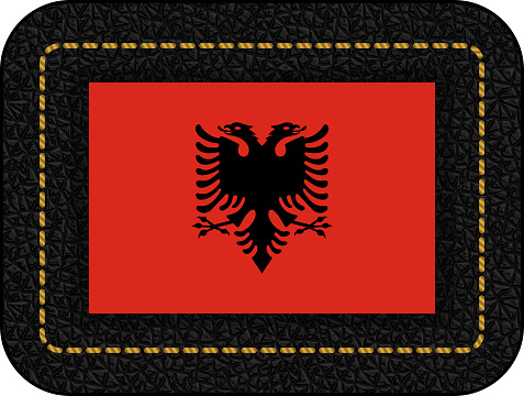 Flag of Albania. Vector Icon on Black Leather Backdrop