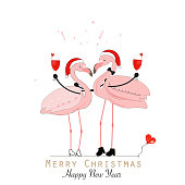 Flamingos. Wine glass with a loving couple. Funny flamingos. The concept of love. Happy New Year and Merry Christmas