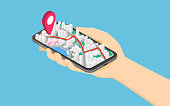 Flat 3d isometric hand holding smartphone with pinpoint on the map application.
