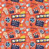 Flat cinema seamless pattern design with film reel, clapper, popcorn, 3D glasses. Cartoon flat Vector Illustration for print, fabric and web-design
