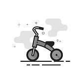 Kids tricycle icon in flat outlined grayscale style. Vector illustration.