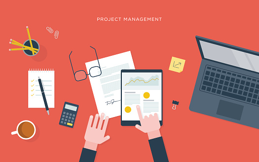 Flat illustration of person at desk with tablet, project management