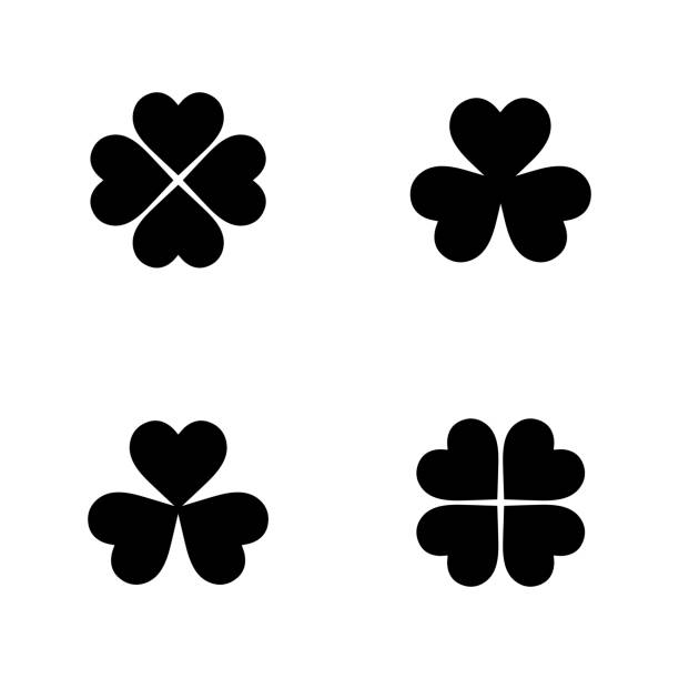 Flat Vector Clover Icon Set Flat monochrome clover icon collection for web sites and apps. Minimal simple black and white clover collection set. Isolated vector black clover collection set on white background. temperate flower stock illustrations