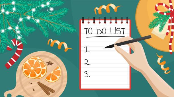 illustrazioni stock, clip art, cartoni animati e icone di tendenza di illustrazione vettoriale piatta di una ragazza che scrive una lista dei desideri. piatto giaceva con ramo albero di natale, regalo e arance. - to do list