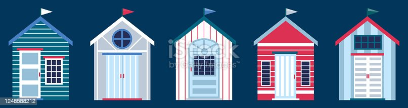 istock Flat vector illustration of colorful beach huts in row isolated on dark blue background. Concept of summer vacation in surfhouse. Beach cabins with flags 1248588212