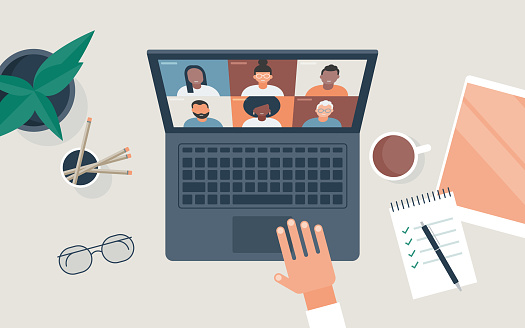 Flat vector illustration of person at desk using computer for video call