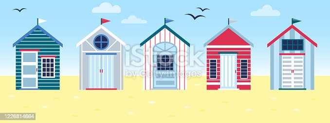 istock Flat vector tropical illustration of colorful beach huts in row on sea side landscape. Concept of summer vacation in surfhouse. Beach cabins with flags 1226814664