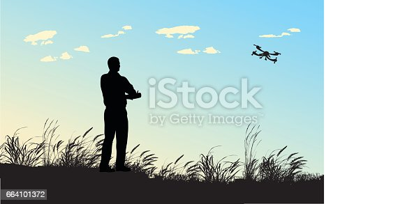 A vector silhouette illustration of an adult man playing with a remote controlled flying drone in a field with wind blown reeds and against a blue sky.