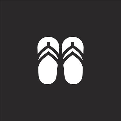 flip flops icon. Filled flip flops icon for website design and mobile, app development. flip flops icon from filled summer clothing collection isolated on black background.