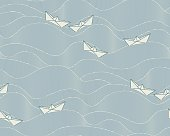 Pattern with floating paper boats on a wavy, slate blue ocean in asian style. The style is oriental, contemporary and elegant. The Pattern can be equally used for maritime, holiday or children related layouts.