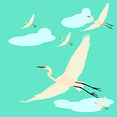Flock of cranes in flying. Vector flat illustration of bird migration isolated on blue background.