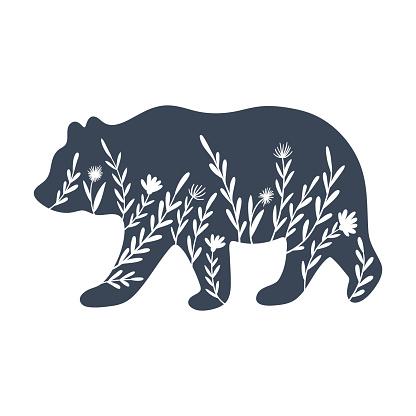 Floral bear silhouette vector illustration. Inverted monochrome design.