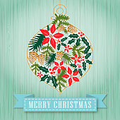 Christmas floral in a Christmas ornament, vintage green color wooden background and paper scroll.