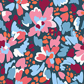 Floral seamless pattern in vintage style. Bright abstract flowers. Flower meadow. Multicolor brush strokes and brush spots. Simple botanical background. Flat design. Good for fashion, textile, fabric.